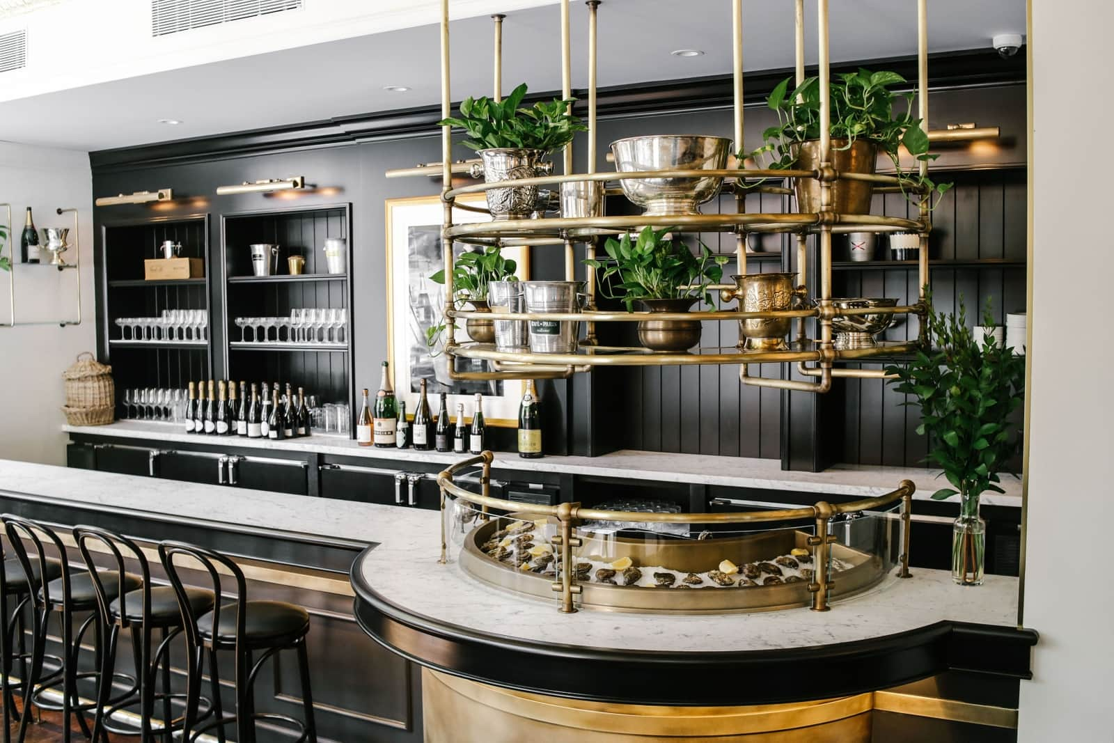 This All-Black Champagne & Oyster Bar in NYC Will Make Us Want To Toast Before New Year's Eve! oyster bar This All-Black Champagne & Oyster Bar in NYC Will Make Us Want To Toast Before New Year's Eve! 2