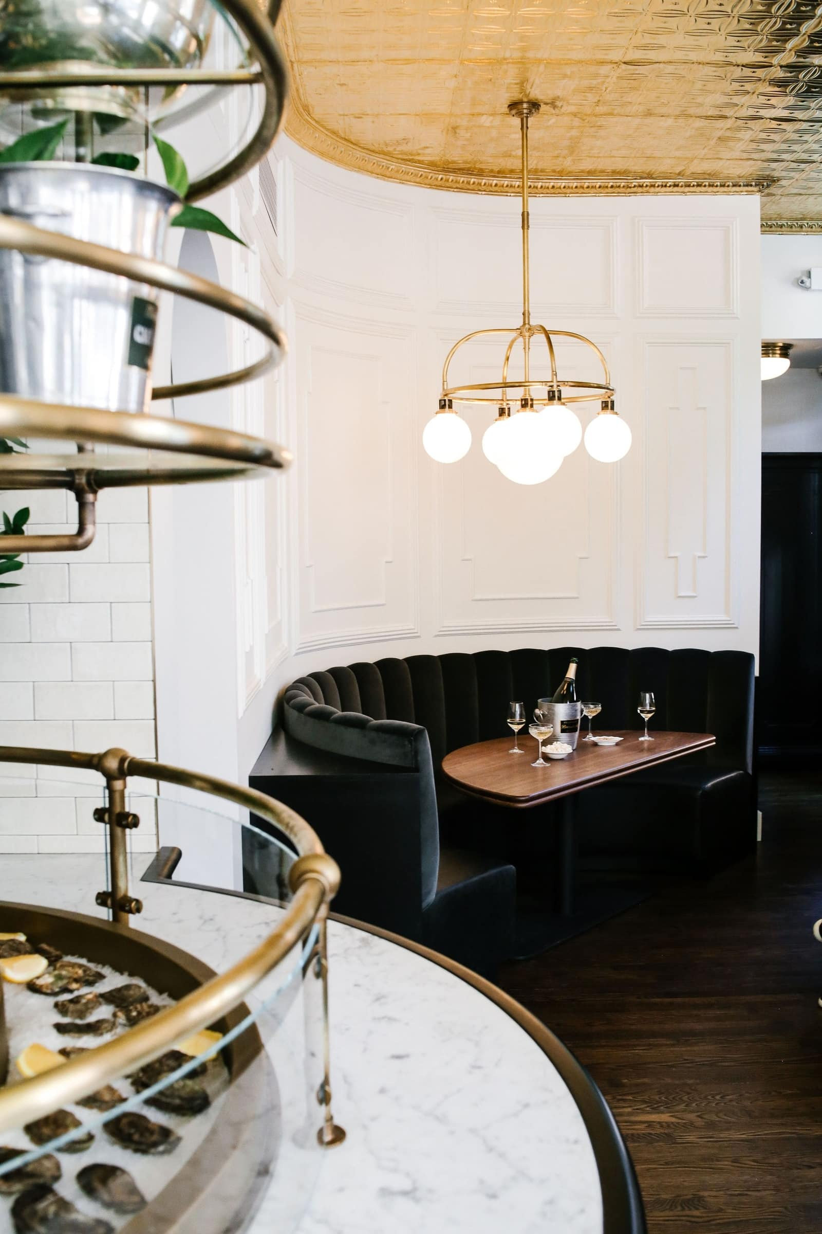 This All-Black Champagne & Oyster Bar in NYC Will Make Us Want To Toast Before New Year's Eve! oyster bar This All-Black Champagne & Oyster Bar in NYC Will Make Us Want To Toast Before New Year's Eve! 3