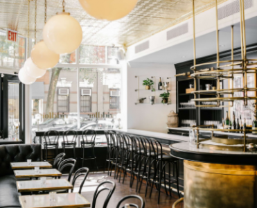 This All-Black Champagne & Oyster Bar in NYC Will Make Us Want To Toast Before New Year's Eve!